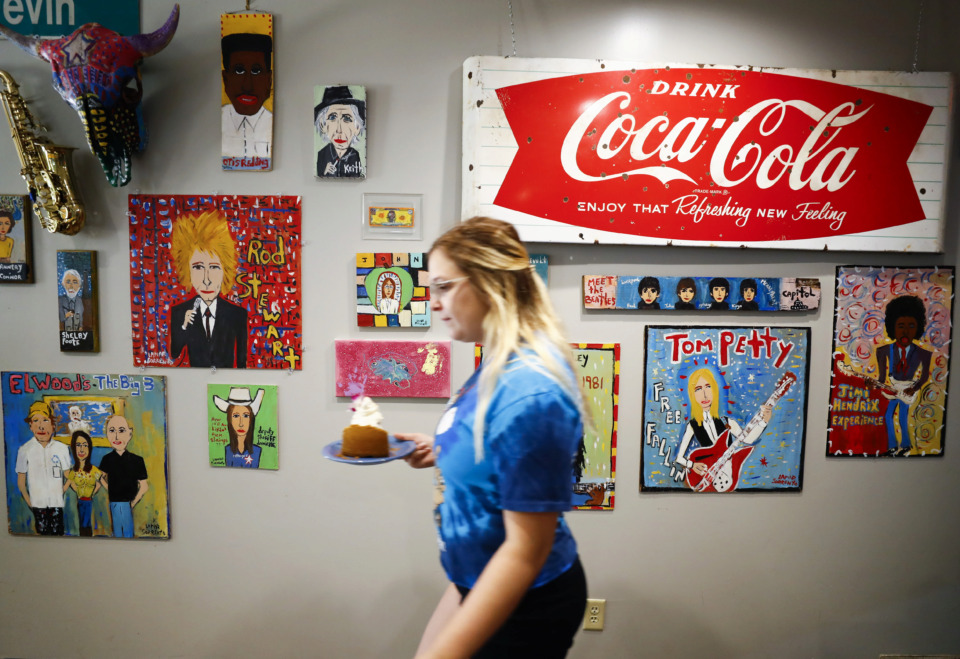 <strong>Elwood's Shells features a colorful interior with artwork by Memphis artist Lamar Sorrento dawning the walls.</strong> (Mark Weber/Daily Memphian)