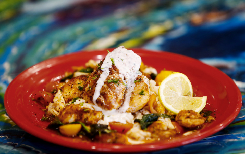 <strong>Lemon Croaker from Elwood's Shells is pan seared and topped with jumbo crab meat, shrimp, spinach, heirloom tomatoes and a lemon meuniere sauce served with white rice.</strong> (Mark Weber/Daily Memphian)