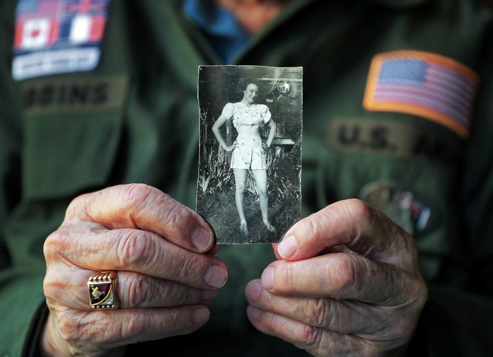 <strong>World War II veteran K.T. Robbins, 97, of Olive Branch, holds a photo that he kept for 75 years of Jeannine Ganaye, the woman he fell in love with in 1944 while he was stationed in northeastern France. With the help of a French television network, the pair were recently reunited during a 75th anniversary of D-Day trip that Robbins took with the Collierville group Forever Young.</strong> (Jim Weber/Daily Memphian)