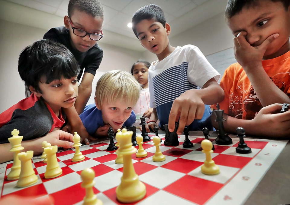 <strong>Kids in Andre Duvall's beginners class band together to try and beat their teacher during the 18th annual Mid-South Chess Camp at Memphis University School this week. Attended by over 120 kids ages 4-16, the camp was established to share a love for the game with lessons in strategy, opening preparation, endgame basics and tactical training.</strong> (Jim Weber/Daily Memphian)