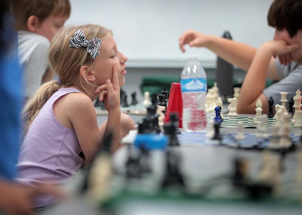 <strong>Cameron Neubauer (left) sheds a sarcastic tear for her opponent during Mid-South Chess Camp at Memphis University School this week. More than 120 young chess players from Memphis and around the U.S. attended the 18th annual camp.</strong>&nbsp;(Jim Weber/Daily Memphian)