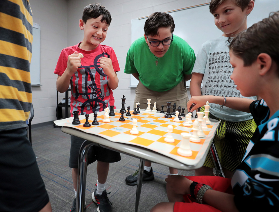"<strong>Anderson Shefsky (left) celebrates taking the upper hand in a game against Zach Muench (right) during the 18th annual Mid-South Chess Camp at Memphis University School this week. ""Chess is a game for everyone, and anyone and everyone can play,"" a counselor said Thursday.</strong>&nbsp;(Jim Weber/Daily Memphian)"