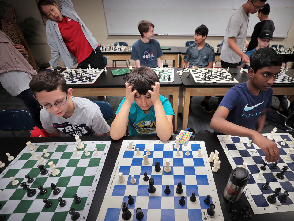 <strong>Kids in the advanced class puzzle over a game scenario during the 18th annual Mid-South Chess Camp on the Memphis University School campus this week. Mid-South Chess says the game teaches integrity, honor, chivalry and education.</strong>&nbsp;(Jim Weber/Daily Memphian)