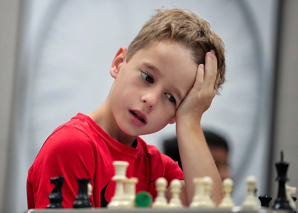 <strong>Courtland Morris, 9, puzzles over a game scenario during the 18th annual Mid-South Chess Camp at Memphis University School this week. Camp instructors are chess grandmasters and masters from the U.S. and around the world.</strong>&nbsp;(Jim Weber/Daily Memphian)