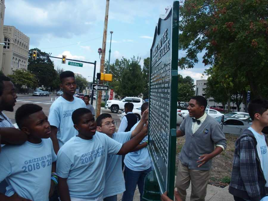 <strong>Students at Memphis Grizzlies Preparatory Charter School examine a historical marker meant to share a more complete story of Nathan Bedford Forrest, a Confederate general, slave trader and early leader of the Ku Klux Klan.</strong> (Laura Faith Kebede/Chalkbeat)