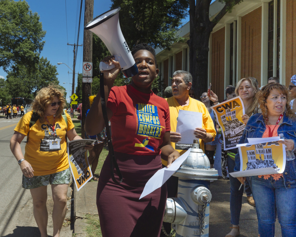 <strong>Jayanni Webster and other members of the United Campus Workers and Communication Workers of America unions rally for a living wage at the University of Memphis on Thursday, June 13, 2019. The U of M recently approved increasing its minimum wage to $11.11 as part of across-the-board pay raises.&nbsp;</strong>(Ziggy Mack/Special to The Daily Memphian)