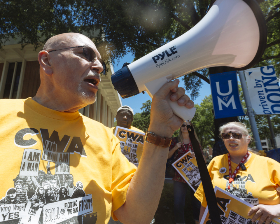 <strong>Arthur Cheliotes, a member of the Communication Workers of America union, rallies with other University of Memphis workers, union members, students and alumni calling for a $15 minimum wage Thursday, June 13, 2019, on the U of M campus.</strong> (Ziggy Mack/Special to The Daily Memphian)