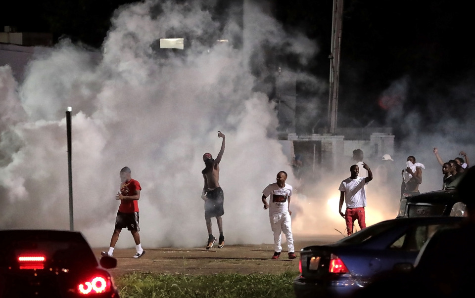 <strong>Angry citizens taunt law enforcement as protesters take to the streets on Wednesday, June 12, 2019, in the wake of the fatal shooting of 20-year-old Brandon Webber by U.S. Marshals in Frayser. Dozens of protesters clashed with authorities, throwing stones and tree limbs until police used tear gas to break up the crowd.</strong> (Jim Weber/Daily Memphian)&nbsp;