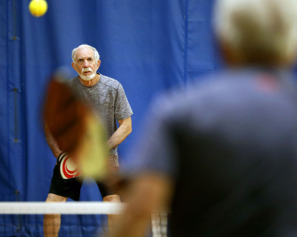 <strong>Morris Powell lines up against Chet Sisk in a game of pickleball on Monday, June 10, 2019, at the Singleton Community Center in Bartlett. An estimated 3 million people play pickleball nationwide, including several hundred locally.</strong>&nbsp;(Patrick Lantrip/Daily Memphian)