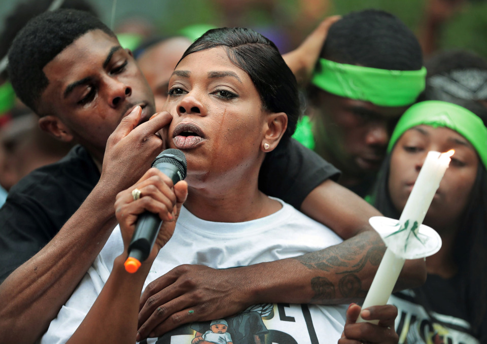 <strong>As Blake Webber wipes away her tears, Jaleta Clark, the mother of 20-year-old Brandon Webber, who was shot by U.S. Marshals on Wednesday, June 12, 2019, remembers her son during a vigil on Durham Avenue in Frayser Friday evening. Hundreds of neighborhood residents gathered with Webber's family to denounce the shooting and the violence that ensued.</strong> (Jim Weber/Daily Memphian)