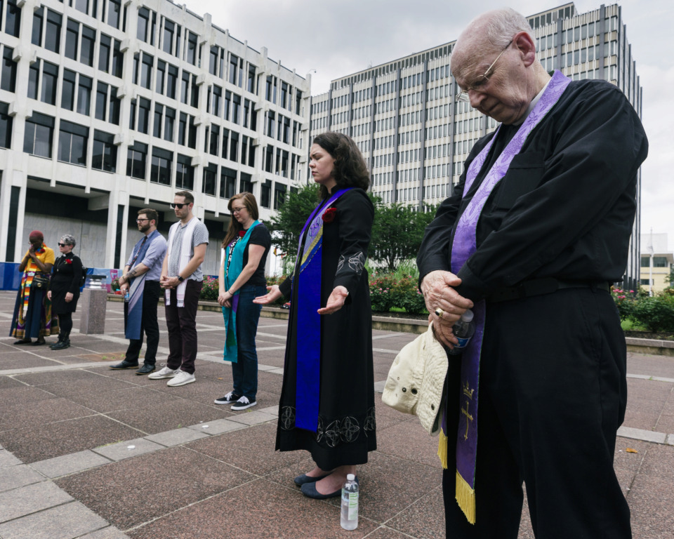 <strong>Fred Morton (from right), Rev. Dr. Courtney Pace, Whitney Brown, Noah Quinton and Sam Teitel join in prayer of various religious denominations for the lost life of recently slain Brandon Webber at a vigil Sunday, June 16, at Memphis City Hall. The vigil was hosted by MICAH (Memphis Interfaith Coalition for Action and Hope).&nbsp;</strong>(Ziggy Mack/Special to the Daily Memphian)