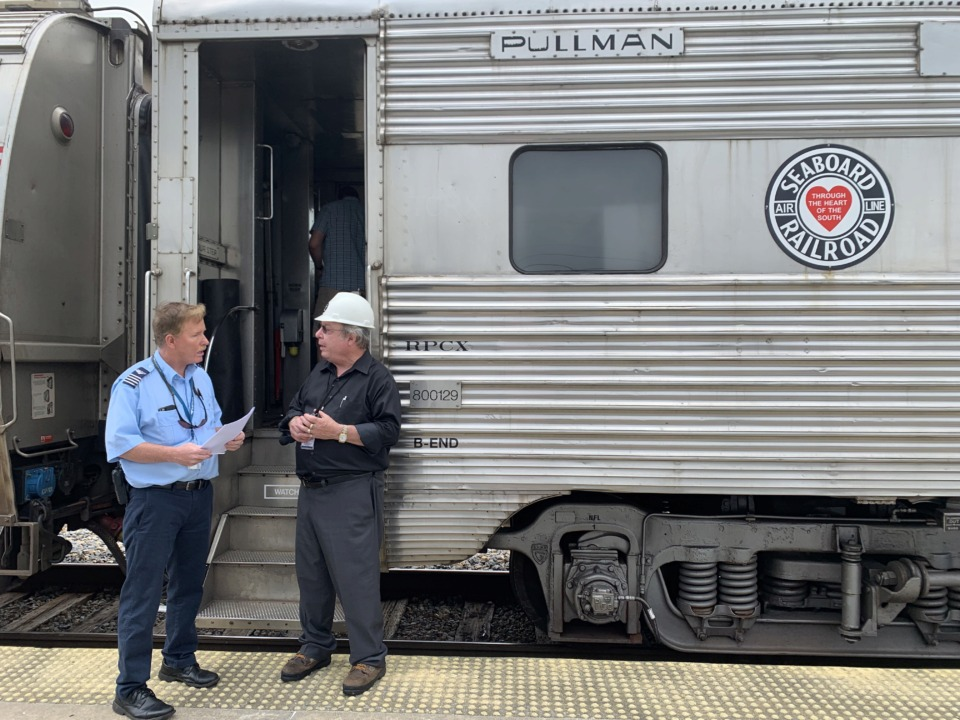 """<strong>The Hollywood Beach Pullman private car from the Seaboard Air Line Railroad is owned by Keith White (right). He restored this train car that was built in 1956 and makes only a few runs a year with it. It is one of only three ever made and the only one like it restored. The Seaboard Air Line Railroad, which styled itself """"The Route of Courteous Service,"""" was an American railroad which existed from April 14, 1900, until July 1, 1967.&nbsp;</strong>(<span class=""""s1"""">Karen Pulfer Focht</span>/Special to The Daily Memphian)"""