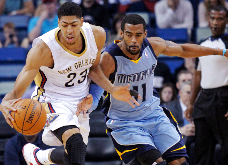 <span><strong>New Orleans Pelicans forward Anthony Davis (23) and Memphis Grizzlies guard Mike Conley (11) battle for the loose ball in an NBA basketball game in New Orleans.</strong> (Scott Threlkeld/Associated Press file)</span>