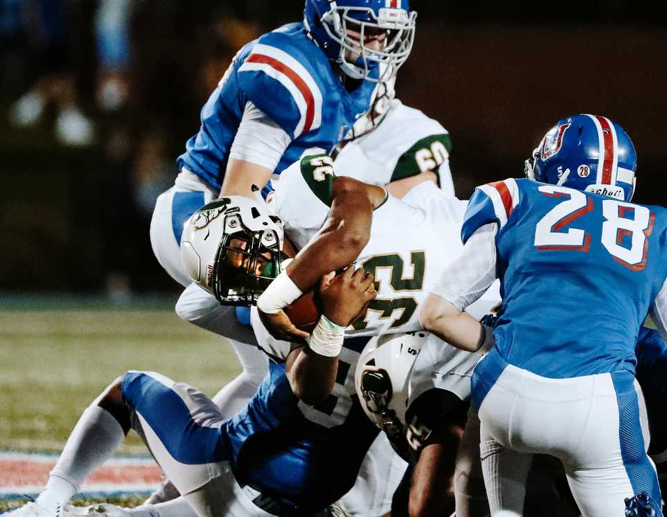 <strong>Briarcrest running back Marlon Hampton dives through an MUS defense Friday, Oct. 12. The MUS Owls have won 14 of their last 15 games against the Saints.&nbsp;</strong>(Houston Cofield/Daily Memphian)