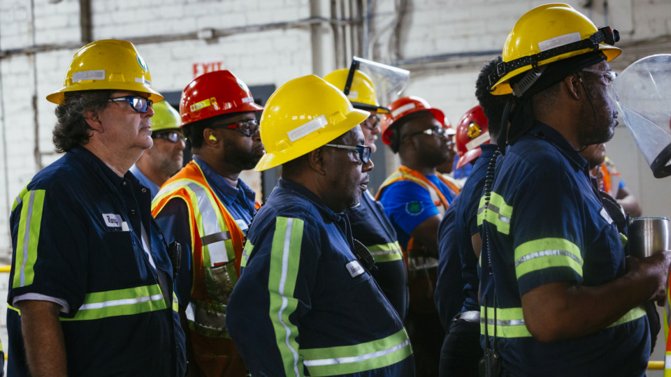 <strong>Employees of Vossloh North America railway construction plant watch a ribbon-cutting ceremony on Tuesday, June 18, 2019, for their new facility located in South Memphis.</strong> (Ziggy Mack/Special to The Daily Memphian)
