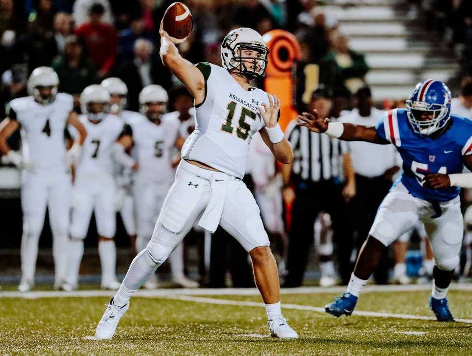 <strong>Briarcrest quarterback Jackson Walker (15) throws a pass as the MUS defense closes in Friday, Oct. 12</strong><strong>.</strong> (Houston Cofield/Daily Memphian)