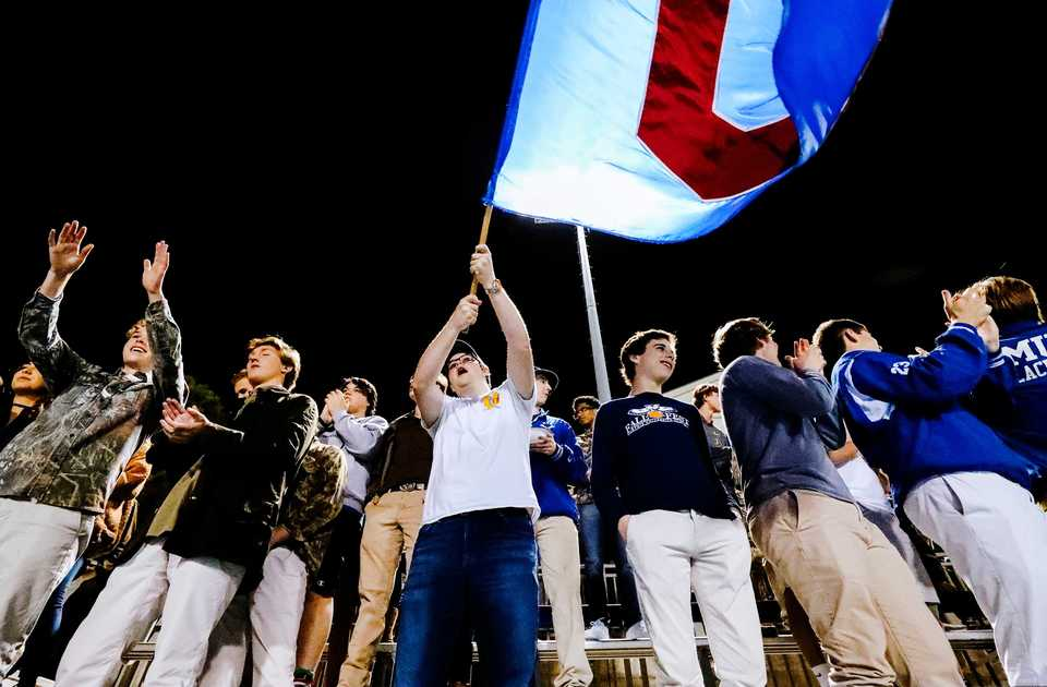 <strong>The MUS student second cheers as their teams scores a second touchdown against Briarcrest Friday, Oct. 12, at MUS. The Owls shut out the Saints 38-0.</strong>&nbsp;(Houston Cofield/Daily Memphian)