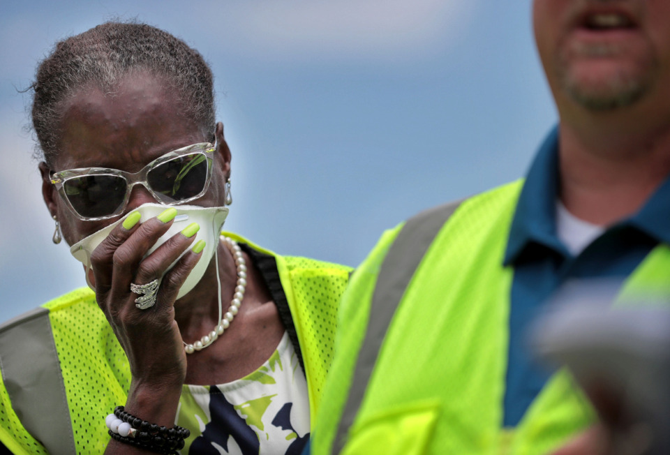 <strong>Yvonne Nelson (left) covers her nose against the odor during a tour of the Waste Connections of Tennessee facility on Brooks Road on June 12, 2019. The Memphis City Council delayed a vote Tuesday on an expansion of the facility.</strong> (Jim Weber/Daily Memphian)