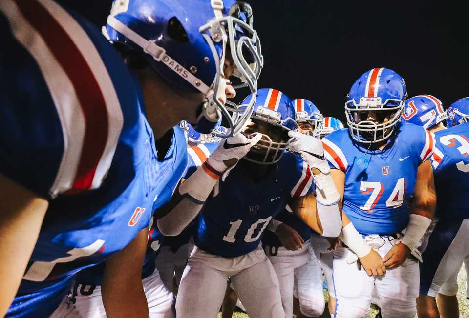 <strong>MUS players huddle in their end zone as the prepare to run onto the field against Briarcrest Friday, Oct. 12. The Owls continued their winning streak, clinching a first-round bye in the state playoffs.&nbsp;</strong>(Houston Cofield/Daily Memphian)