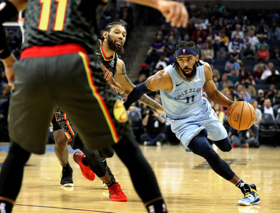 <strong>Mike Conley drives to the basket during a 2018 Grizzlies game against the Atlanta Hawks at FedExForum in Memphis. The Grizzlies traded Conley to the Utah Jazz on Wednesday, June 19, ending one era but bolstering the new one.</strong> (Daily Memphian file)