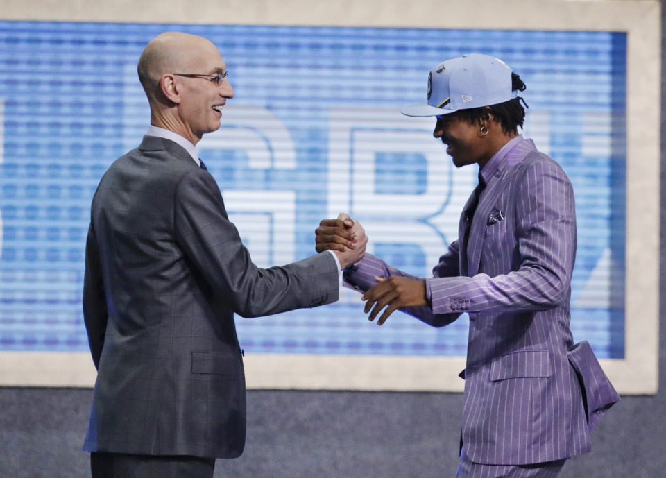 <strong>Ja Morant is greeted by NBA Commissioner Adam Silver after being selected by the Memphis Grizzlies with the second pick in the NBA draft Thursday, June 20, 2019, in New York.</strong> (AP Photo/Julio Cortez)