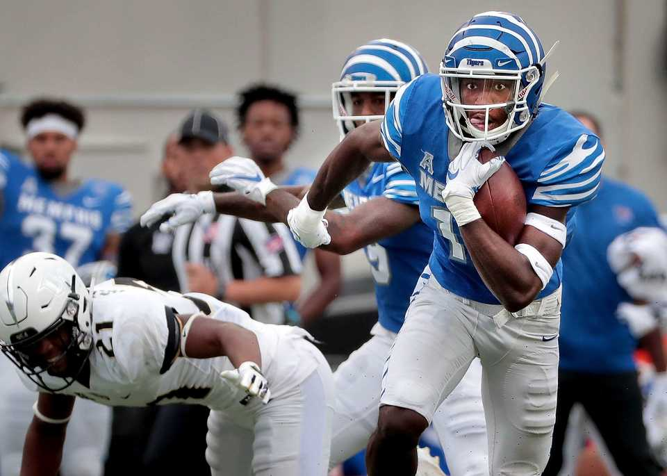 <strong>University of Memphis receiver Damonte Coxie (10) looks for an opening on a run during the Tigers' disappointing 31-30 loss to UCF at the Liberty Bowl Memorial Stadium on Oct. 13, 2018.</strong> (Jim Weber/Daily Memphian)