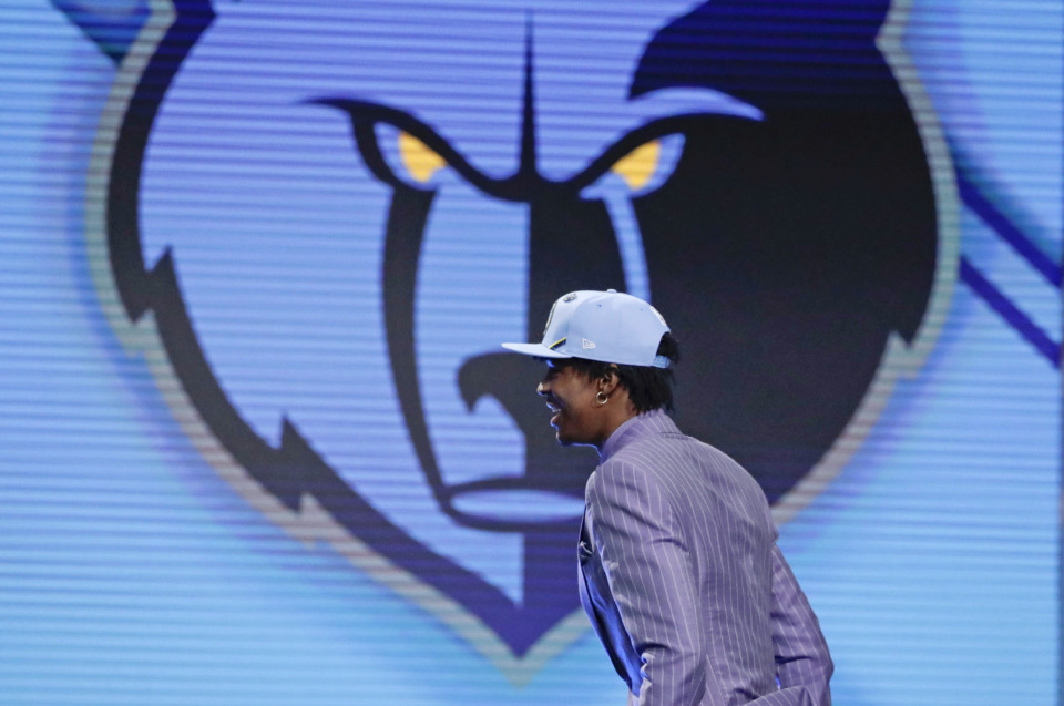<span><strong>Murray State's Ja Morant walks on stage after being selected with the second pick overall by the Memphis Grizzlies during the NBA basketball draft Thursday, June 20, 2019, in New York.</strong> (AP Photo/Julio Cortez)</span>