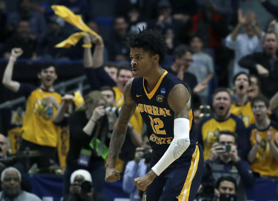 "<span><strong>Memphis Grizzlies draft pick Ja Morant expects to draw some fans who watched him play for the Murray State Racers in western Kentucky. ""Racer Nation will fill out this arena,"" he said at his introductory press conference at FedExForum Friday.</strong>&nbsp;(AP Photo/Elise Amendola)</span>"