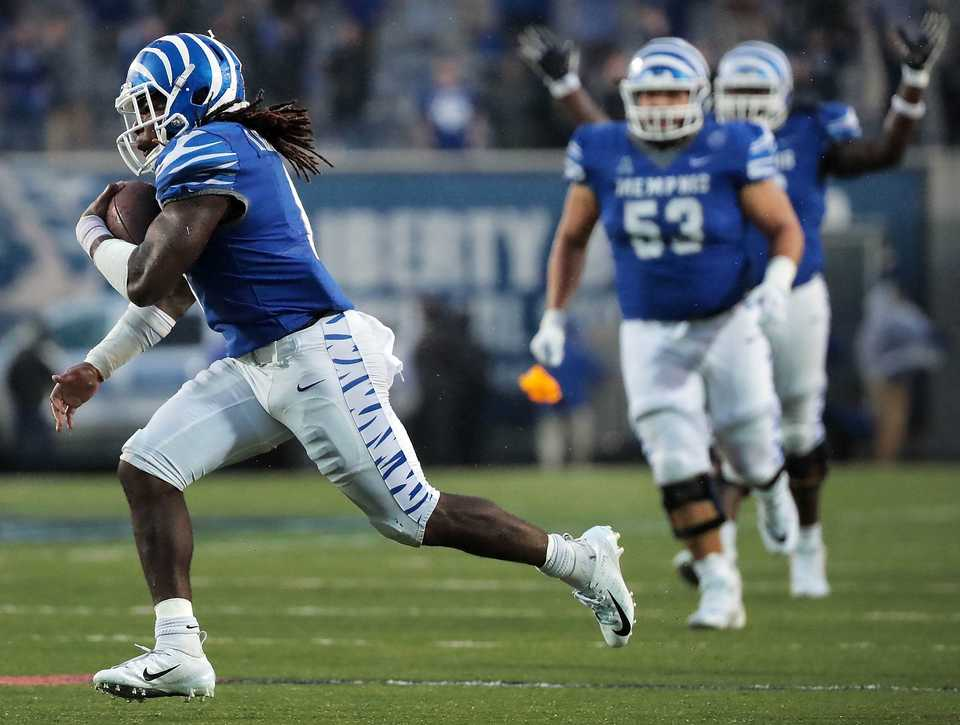 <strong>University of Memphis running back Darrell Henderson (8) runs in for a defunct touchdown after a penalty flag was thrown in the last minutes of the Tigers' disappointing 31-30 loss to UCF at the Liberty Bowl Memorial Stadium on Oct. 13, 2018.</strong> (Jim Weber/Daily Memphian)