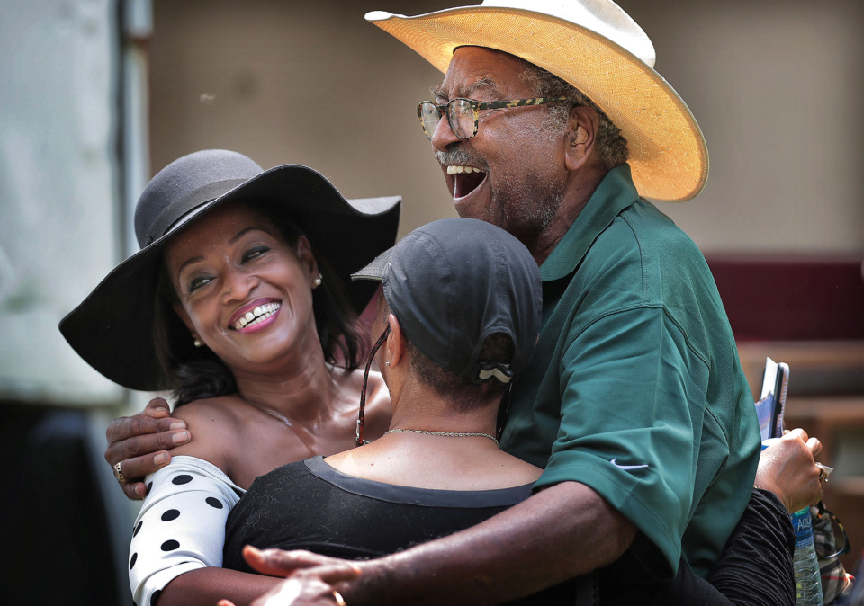 <strong>Sidney Chism (right) is embraced by Shelby County Clerk Wanda Halbert (left) and Brenda Chism-Love during the former county commissioner's annual political picnic Saturday behind Horn Lake Learning Center in southwest Memphis.</strong> (Jim Weber/Daily Memphian)