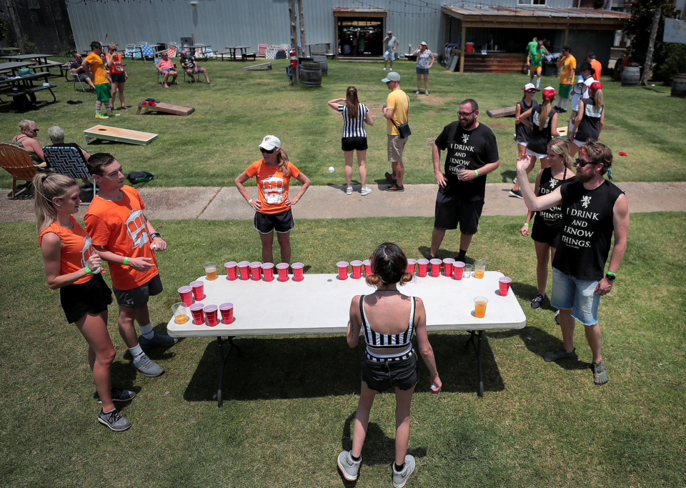 <strong>Teams play a double elimination tournament in both beer pong and cornhole Saturday at Loflin Yard. The Downtown Olympics was a fundraiser for Urban Bicycle Food Ministry.</strong> (Jim Weber/Daily Memphian)