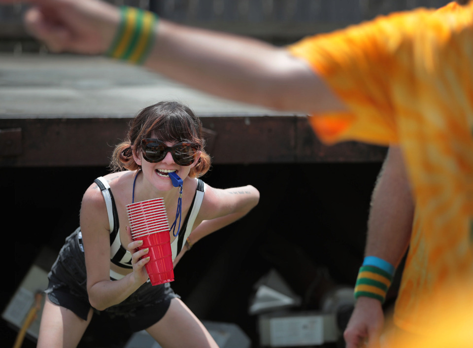 <strong>Referee Jordan Bell keeps an eye out for fouls while officiating beer pong Saturday during the Downtown Olympics at Loflin Yard.</strong> (Jim Weber/Daily Memphian)