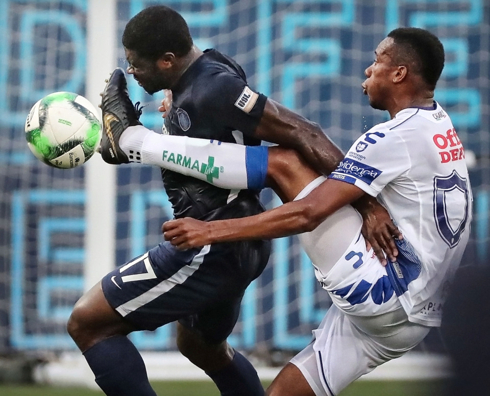 <strong>Memphis midfielder Ewan Grandison takes a foot to the chest Saturday from Pachuca forward Jonathan Copete during 901 FC's 6-1 loss to the squad from Mexico at AutoZone Park.</strong> (Jim Weber/Daily Memphian)