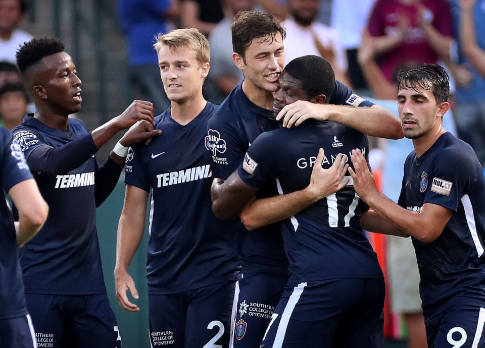 <strong>Memphis forward Elliot Collier (center) celebrates with teammate Ewan Grandison after scoring against Pachuca during 901 FC's 6-1 loss to the squad from Mexico at AutoZone Park.</strong> (Jim Weber/Daily Memphian)