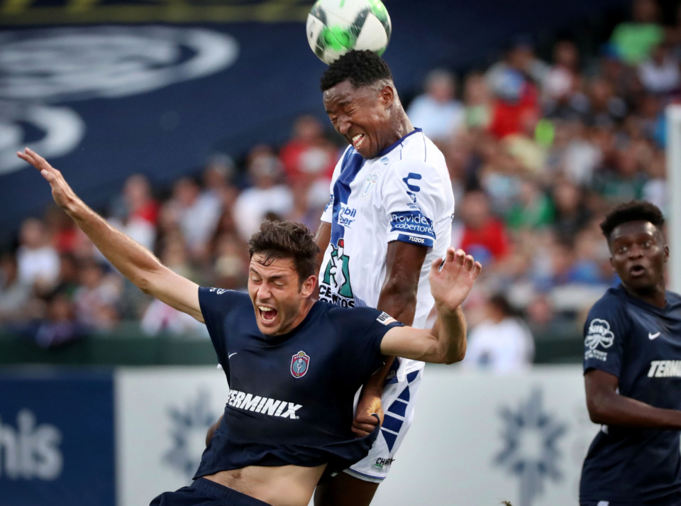 <strong>Memphis forward Elliot Collier (left) collides with Pachuca defender &icirc;scar Murillo during 901 FC's 6-1 loss to the squad from Mexico.</strong> (Jim Weber/Daily Memphian)