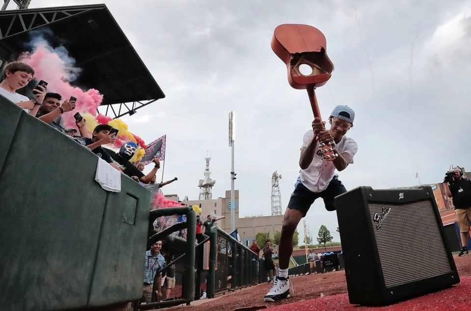 <strong>Grizzlies draft pick Ja Morant crushes the guitar to kick off 901 FC's game against Pachuca in front of a sellout crowd at AutoZone Park.</strong> (Jim Weber/Daily Memphian)