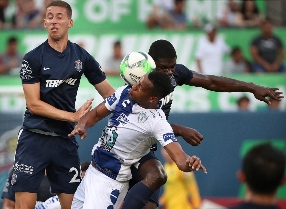 <strong>Memphis defender Josh Morton (left) and midfielder Ewan Grandison collide Saturday with Pachuca forward Jonathan Copete during 901 FC's 6-1 loss to the squad from Mexico.</strong> (Jim Weber/Daily Memphian)