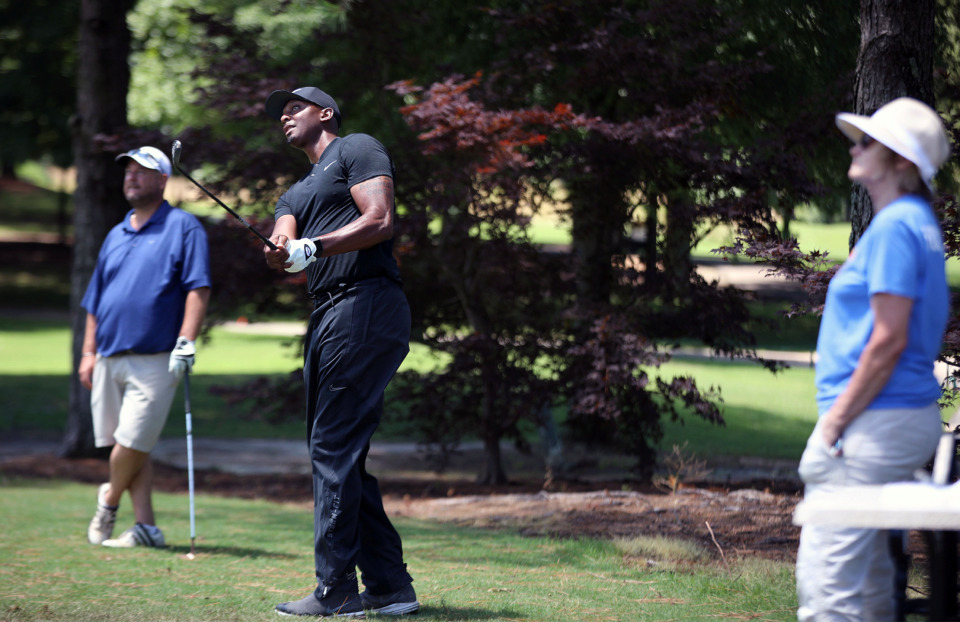 <strong>University of Memphis head basketball coach Penny Hardaway during the AutoZone Liberty Bowl Golf Classic at TPC Southwind course Monday, June 24, while Joe Bell (left) watches in the background.</strong> (Patrick Lantrip/Daily Memphian)