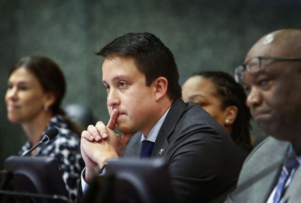 <strong>Shelby County Commissioner Michael Whaley (middle) listens along with other commissioners to a speaker during a session Monday, June 24, discussing budget proposals for fiscal year 2019-20.&nbsp;The budget passed in a 9-1 vote, with Commissioner Mick Wright voting against it. Whaley voted for the budget. Commissioner Brandon Morrison, left, abstained.</strong> (Mark Weber/Daily Memphian)