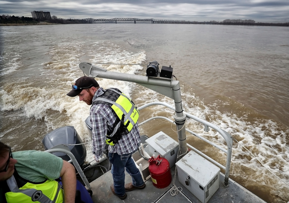 <strong>Construction control inspector Travis Clark with the U.S. Army Corps of Engineers' Memphis District checks water levels and levee conditions along the Mississippi River Feb. 27, 2019. The Corps and the Mississippi River Parks Partnership are in discussions to determine whether a revamp of Tom Lee Park will require a Corps permit to safeguard the dike structure and public safety.&nbsp;</strong>&nbsp;(Jim Weber/Daily Memphian)