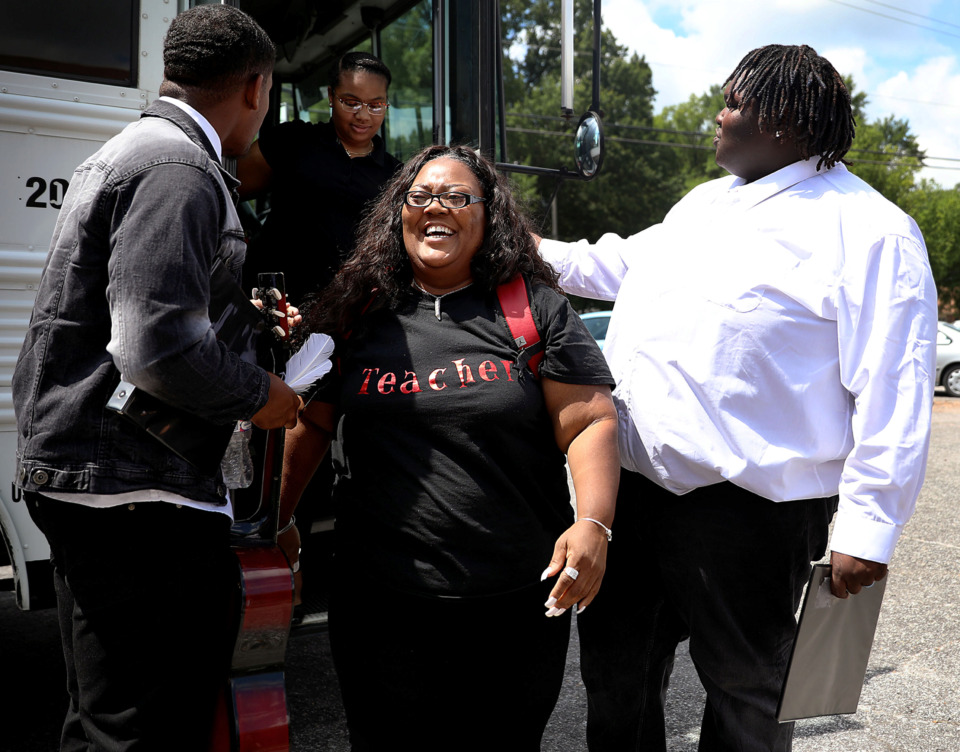 <strong>Kentosha Evans can't help but smile after going on a teen-led bus tour of Whitehaven that was highlighted with performances by Ronnie Wesby and Lonnie Graham, who helped her off the bus Tuesday, June 25.</strong> <strong>The tour is part of the Blues City Cultural Center's summer programming in Whitehaven.</strong>&nbsp;(Patrick Lantrip/Daily Memphian)