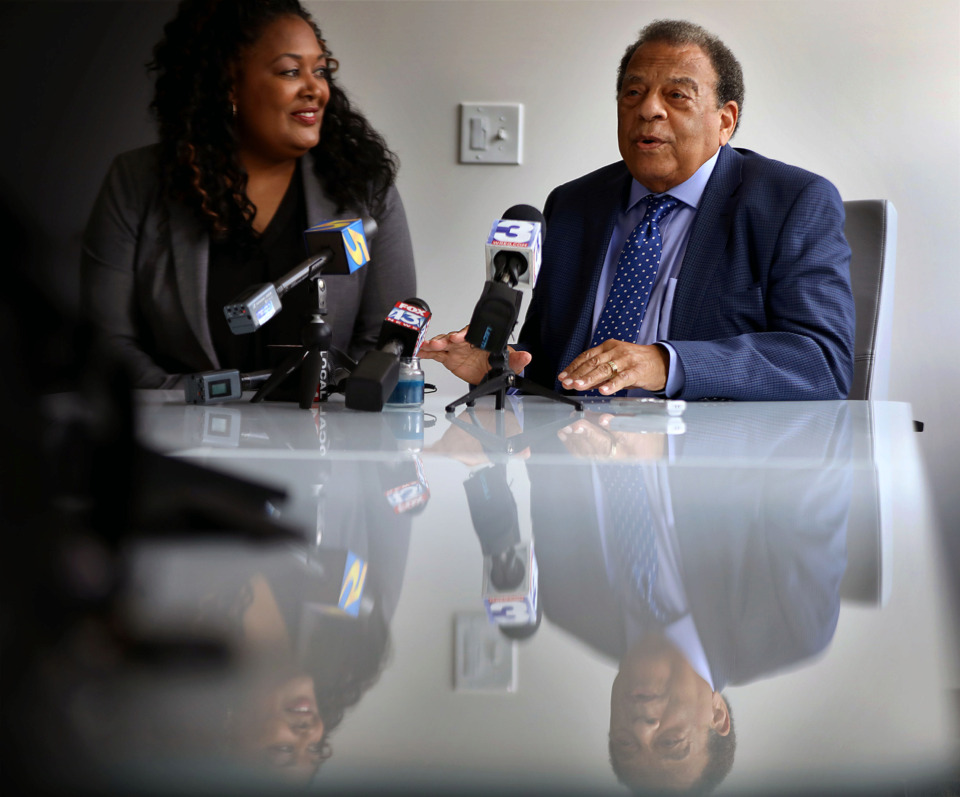 <strong>Civil rights icon and former Atlanta mayor Andrew Young (with Joann Massey, director of the Office of Business Diversity and Compliance) talks to the media before the city&rsquo;s annual minority business conference Wednesday, June 26, at the Universal Life Insurance building. Young is an adviser to the Mississippi River Cities and Towns Initiative, a coalition of cities along the Mississippi River formed to promote the river as a tourism and trade corridor.</strong> (Patrick Lantrip/Daily Memphian)