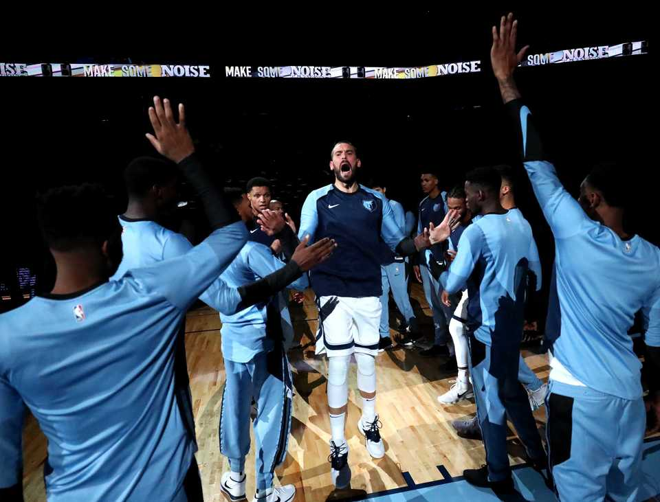 <strong>Grizzlies center Marc Gasol celebrates with teammates as he enters FedExForum for the first pre-season game of the year against the Atlanta Hawks. The Grizzlies beat the Hawks 110-120 in the first pre-season game of the year.</strong> (Houston Cofield/Daily Memphian)