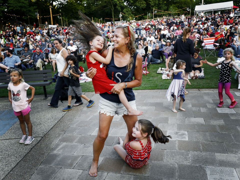 <strong>Holly Mosteller (middle) dances with her granddaughters Ava Price,4, (left) and Mallory Mosteller (rihgt) during the Patriotic Pops with the Memphis Wind Symphony performance at the Levitt Shell Thursday, June 27, 2019.</strong> (Mark Weber/Daily Memphian)