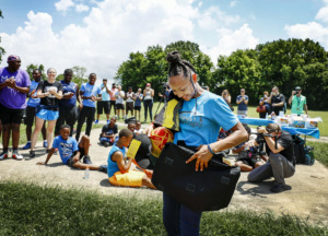 <strong>Memphis Inner City Rugby player Jamiyah Brown, 11, was surprised during an event Friday, June 28, with the opportunity to deliver the official game ball at the Rugby World Cup 2019 in Japan, courtesy of DHL Express. Jamiyah will deliver the game ball to the professional athletes representing the U.S.</strong> (Mark Weber/Daily Memphian)