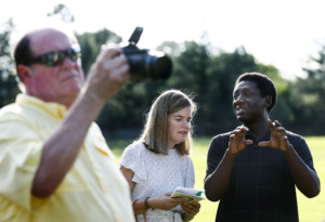 <strong>District Attorney Amy Weirich (middle) speaks with Kevin Reed during the Elephants in the Park event Friday evening at Marquette Park in East Memphis.</strong> (Mark Weber/Daily Memphian)