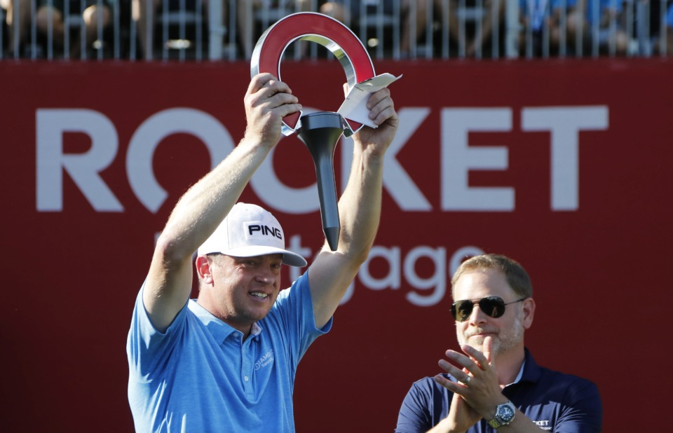 <span><strong>Nate Lashley raises the winner's trophy after the final round of the Rocket Mortgage Classic golf tournament, Sunday, June 30, 2019, in Detroit.</strong> (AP Photo/Carlos Osorio)</span>