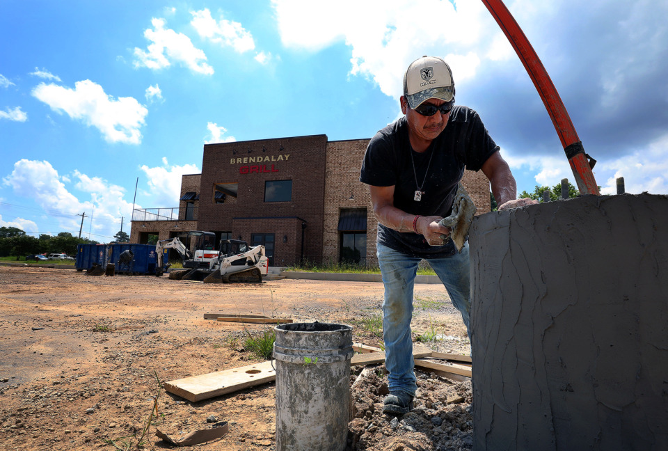 <strong>Francisco Hernandez works to put the finishing touches on the rebuilt Brendalay Grill in Arlington Monday, July 1, which burned down more than two years ago.</strong> (Patrick Lantrip/Daily Memphian)