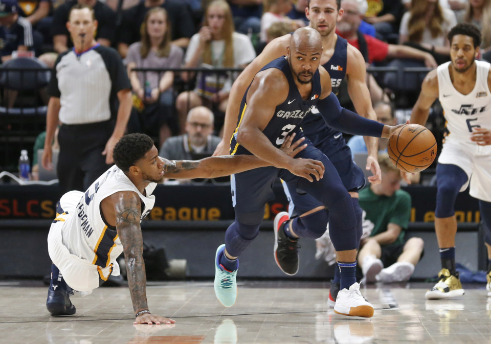 <span><strong>Utah Jazz's Justin Wright-Foreman (3) falls as he guards Memphis Grizzlies' Jevon Carter (3) during the first half of an NBA summer league basketball game Monday, July 1, in Salt Lake City.</strong> (Rick Bowmer/Associated Press)</span>