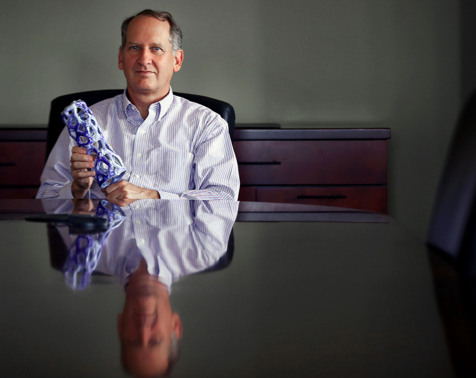 <strong>Brandon Wellford, CFO of the Memphis Bioworks Foundation, holds a new Osteon Defender cast at their offices in the Memphis Medical District on Tuesday, July 2, 2019.</strong> (Patrick Lantrip/Daily Memphian)